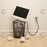 cutcaster-photo-100127162-Computer-in-trash-can